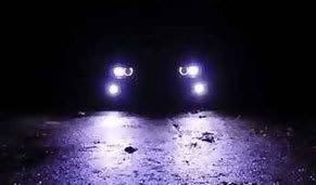Headlights at night.