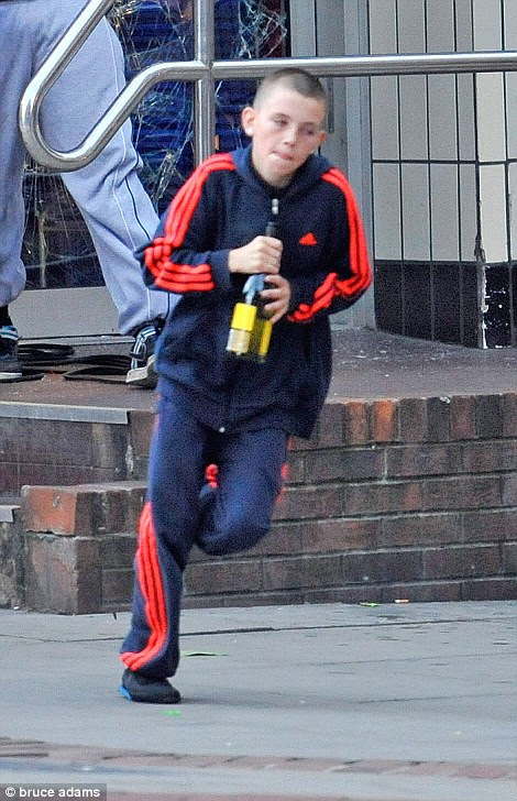 Looters - including a young boy - rob drink from Sainsbury's Local store in Manchester