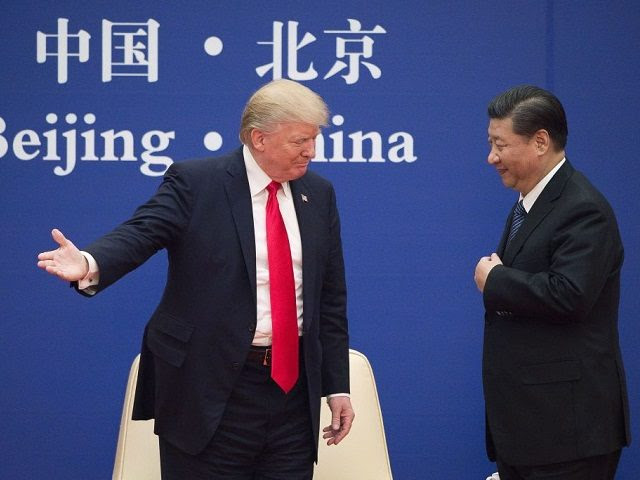 """TOPSHOT - US President Donald Trump (L) gestures next to China's President Xi Jinping during a business leaders event at the Great Hall of the People in Beijing on November 9, 2017. Donald Trump urged Chinese leader Xi Jinping to work """"hard"""" and act fast to help resolve the North …"""