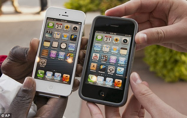 Old and new: Apple's new iPhone 5, left, is a bit longer and thinner than the older iPhone 4s, right