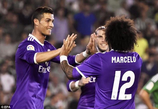 Cristiano Ronaldo congratulates Marcelo for scoring Real Madrid's third at Real Betis