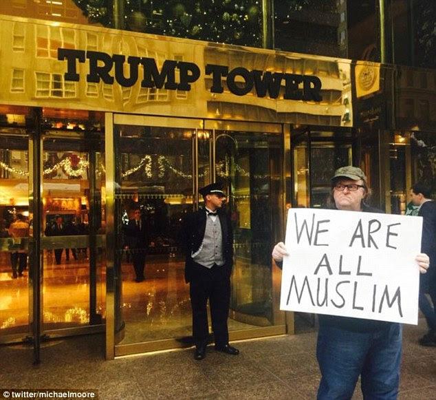 Velez, 20 ans, a lancé une tirade anti-musulmane au cinéaste Michael Moore jeudi après il a partagé une photo (ci-dessus) de lui-même à l'extérieur de la Trump Tower à New York avec une pancarte: 'Nous sommes tous musulmans'