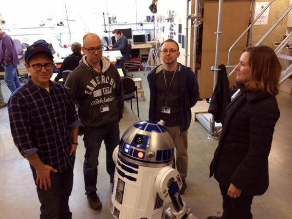 STAR WARS: EPISODE VII director J.J. Abrams, Lucasfilm president Kathleen Kennedy and two staff members pose with R2-D2.