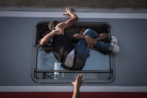 Migrants attempting to board a train in Tovarnik, Hungary, that was headed to Zagreb, Croatia. Sept. 18, 2015. (First prize, general news, stories.)