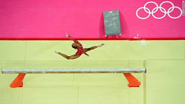 Gabrielle Douglas of the United States performs on the balance beam in the women's gymnastics team final on Day 4 of the London Olympics on Tuesday, July 31. Check out <strong><a href='http://www.cnn.com/2012/07/30/worldsport/gallery/olympics-day-three/' target='_blank'>Day 3 of competition</a></strong> from Monday, July 30. The Games run through August 12. See all the action as it unfolds here.