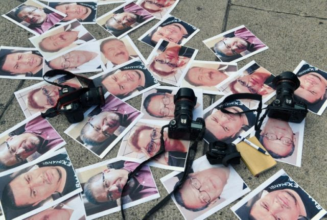 Pictures of journalists recently murdered in different Mexican states lay on the ground at Independence Angel square during a protest by journalists in Mexico City, on May 16, 2017