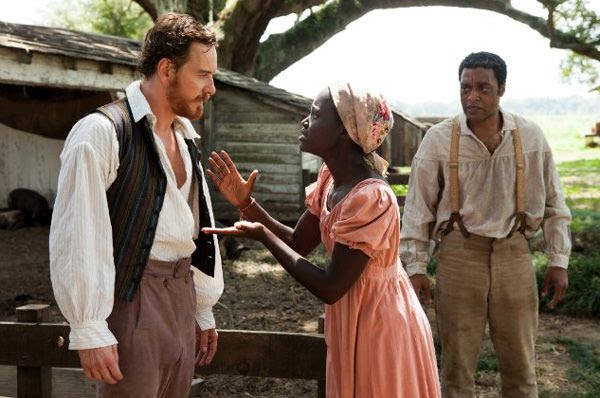 Michael Fassbender, Lupita Nyong'o and Chiwetel Ejiofor in a scene from 12 YEARS A SLAVE.