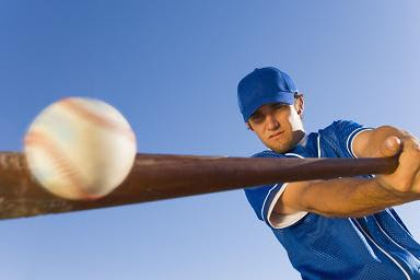 player hitting baseball