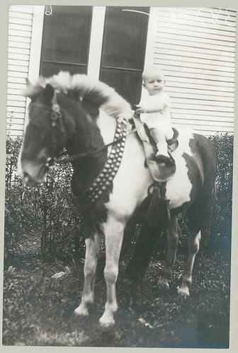 Baby on pony