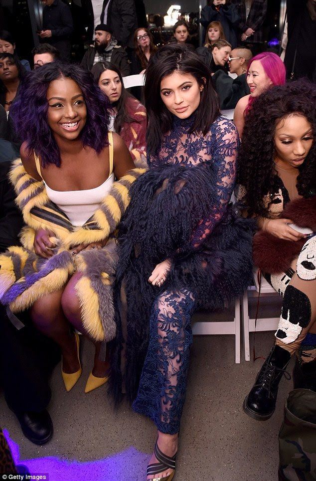 Fashion queens: The 18-year-old sat front row with pal Justine Skye (left) and stylist Rox Brown (left)
