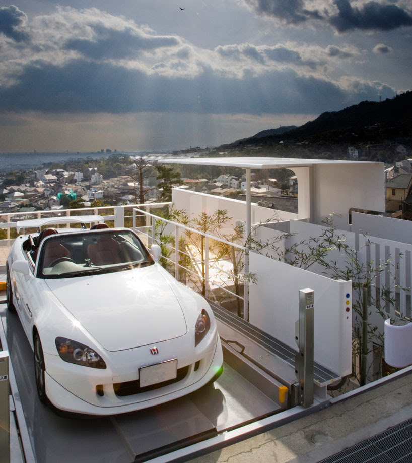kenji yanagawa's case study house frames city and luxury cars