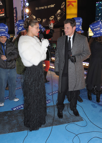 "Vanessa Minnillo and musician Nick Lachey, co-hosts of the NIVEA Kiss Platform, pose in Times Square on New Year's Eve where they rang in 2010 as a year of ""Love, Hugs and Kisses"" on December 31, 2009 in New York City."