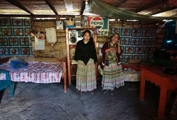 Alicia Chiquin, 43, and her daughter Fidelina Ja, 18, stand together at their home in Pambach, Guatemala. Alicia has no education and has always worked the land. Her daughter Fidelina also has no education and when she grows up she says she will continue to work at home and on the land.