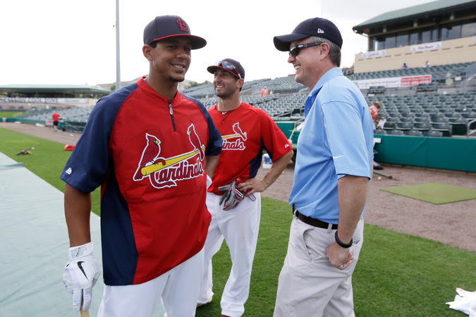 Jeff Luhnow, the Houston Astros' general manager, with Jon Jay, left, and Daniel Descalso of the Cardinals in 2013.