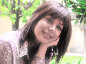Neda Agha-Soltan, 26, was shot to death in Tehran on Saturday.