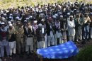 Tribesmen attend a funeral of a paramilitary soldier who was kidnapped and executed by Taliban militants at Darra Adam Khel