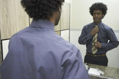 Discrimination Against Natural Hair in the Workplace - Woman