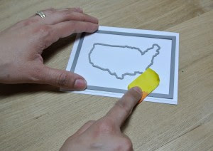 First I die cut the stitched rectangle die and the United States outline map.