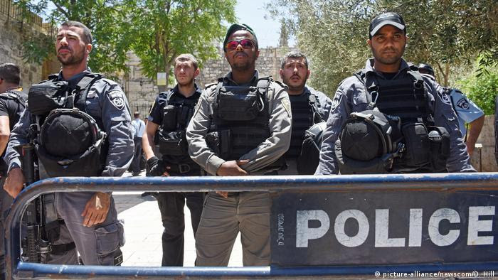 Israeli security for   ces stand guard near an entrance to the Temple Mount.