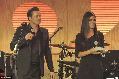 Star-studded: Sandra appeared on stage during the event next to the non-profit founder Brad Pitt