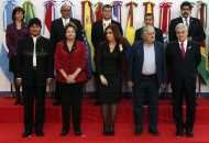 Leaders, from left to right in the front row, Bolivia's President Evo Morales, Brazil's President Dilma Rousseff, Argentina's President Cristina Fernandez, Uruguay's President Jose Mujica, Chile's President Sebastian Pinera, pose for a group photo with, back row left to right, Colombia's Foreign Minister Maria Holguin, Suriname's President Desi Bouterse, Ecuador's President Rafael Correa, Peru's President Ollanta Humala, and Venezuela's Foreign Minister Nicolas Maduro at a meeting by the Union of South American Nations (UNASUR) in Mendoza, Argentina, Friday, June 29, 2012. (AP Photo/Natacha Pisarenko)