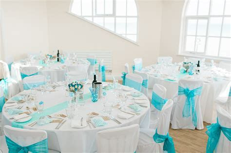 Turquoise Wedding at the Seaside with 31 Guests · Rock n