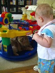 Jasper playing in Clara Ann's exersaucer
