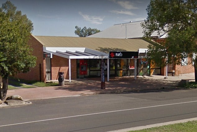 The petrol station worker alerted police setting up a roadside breath test near the National Australia Bank in Mitchell