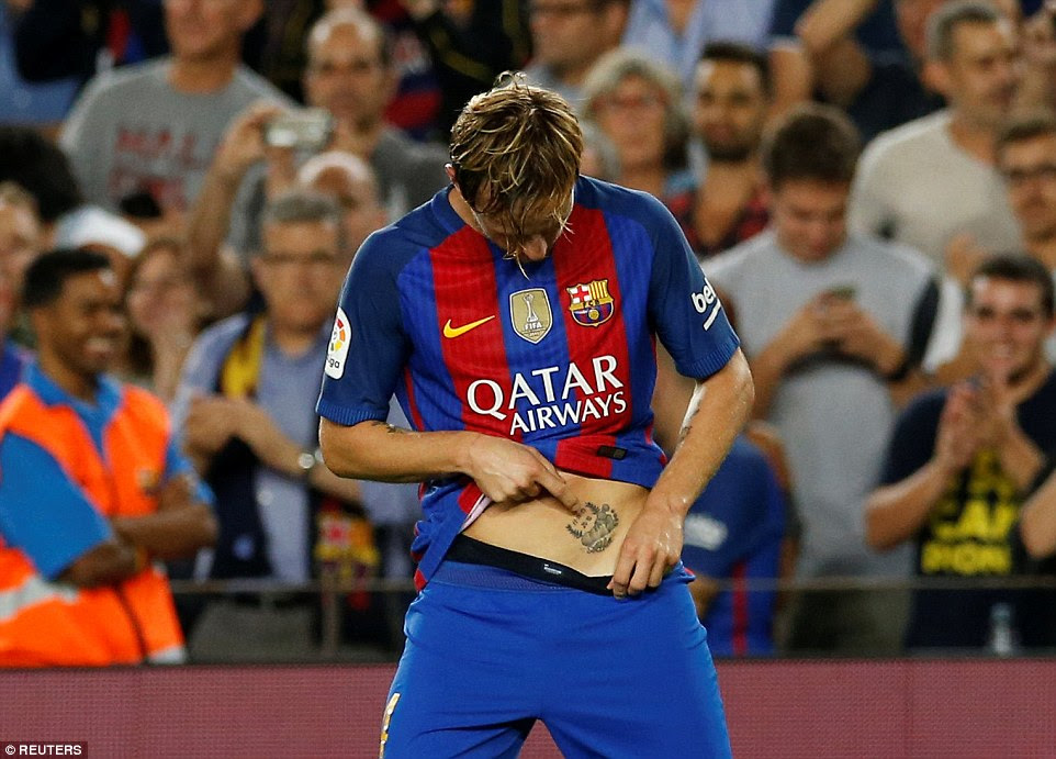Barcelona ace Rakitic celebrates his goal in unusual fashion by showing off his tattoo near his groin area