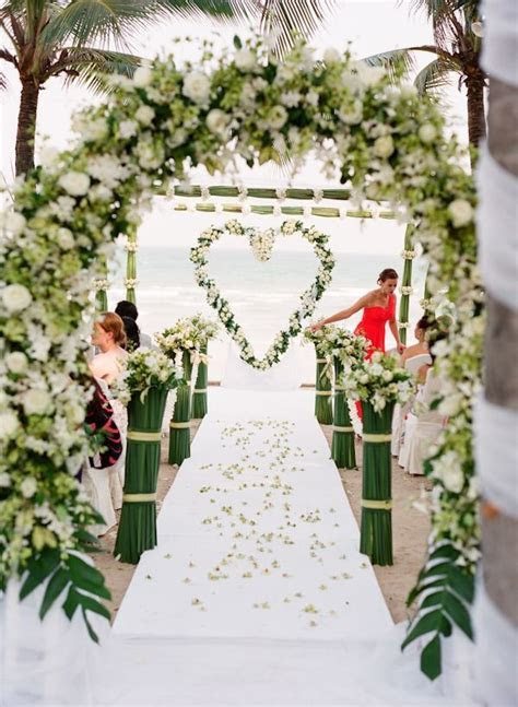 Heart shaped floral wreath as a ceremony backdrop   Floral