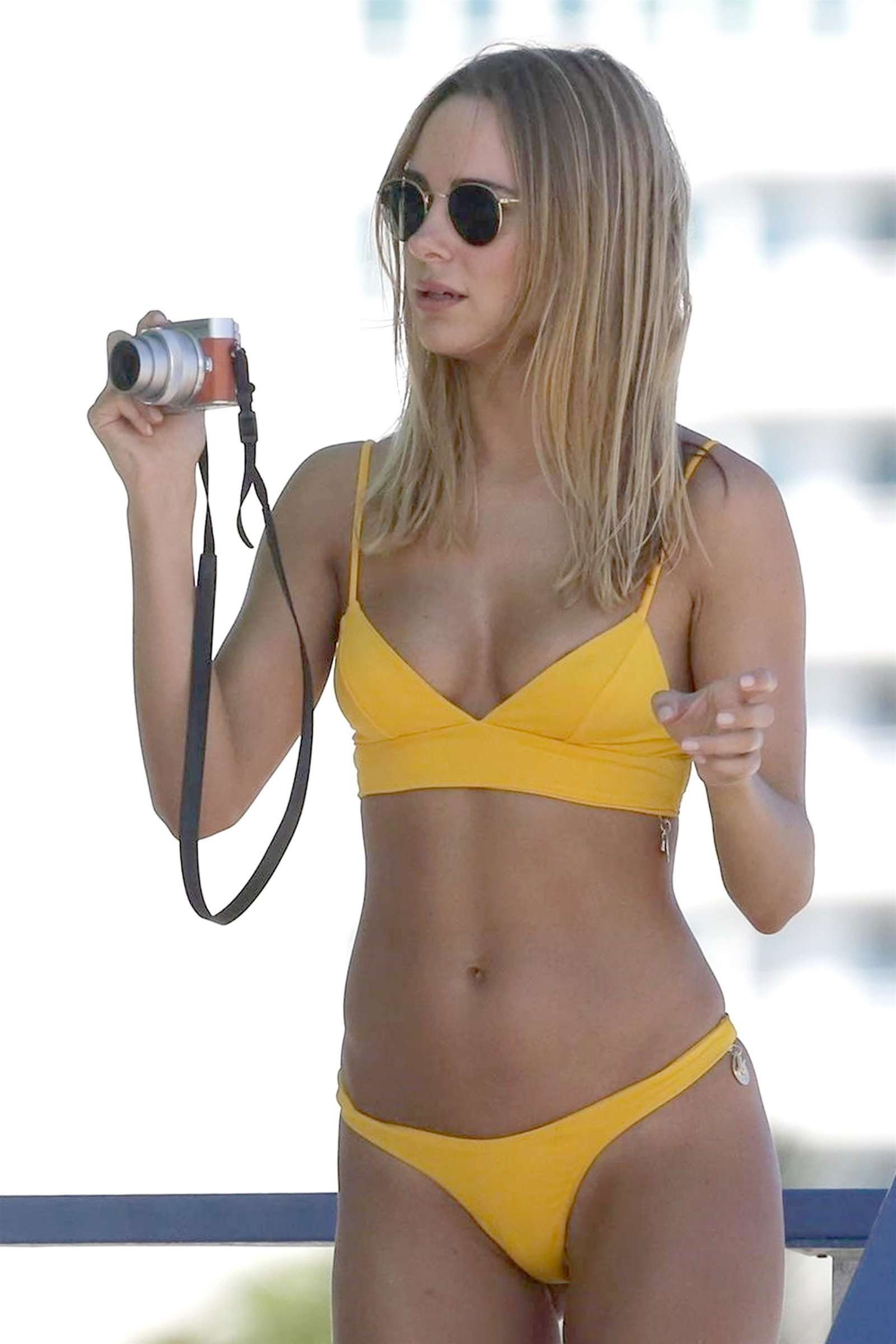 Kimberley Garner in Yellow Bikini on the beach in Miami