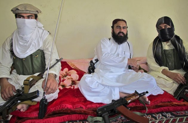 Deputy Pakistani Taliban leader Wali-ur-Rehman (C) is flanked by militants as he speaks to a group of reporters in Shawal town, which lies between North and South Waziristan region in the northwest bordering Afghanistan, in this July 28, 2011 file photo. A U.S. drone strike killed the number two of the Pakistan Taliban, Wali-ur-Rehman, in North Waziristan region on May 29, 2013, three security officials said in what would be a major blow in the fight against militancy. REUTERS/Saud Mehsud/File  (PAKISTAN - Tags: POLITICS CIVIL UNREST CRIME LAW)