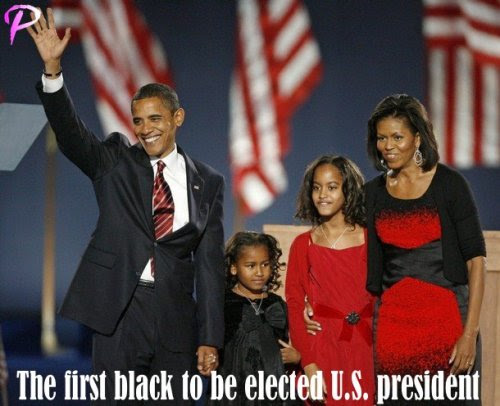U.S. President-elect Senator Barack Obama (D-IL) stands with his wife Michelle and their daughters Malia (2nd R) and Sasha as they face supporters at his election night rally after being declared the winner of the 2008 U.S. Presidential Campaign in Chicago, November 4, 2008.