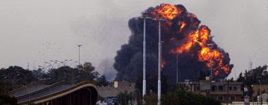 A huge explosions is seen over the outskirts of Benghazi after a plane of Gadhafi's forces was shot down over eastern Libya. (AP Photo/Anja Niedringhaus)