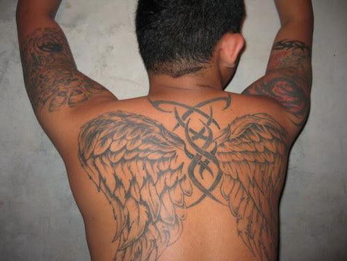 tribal tattoos latin 5. omega shoulder tattoo designs. Angel Wings and