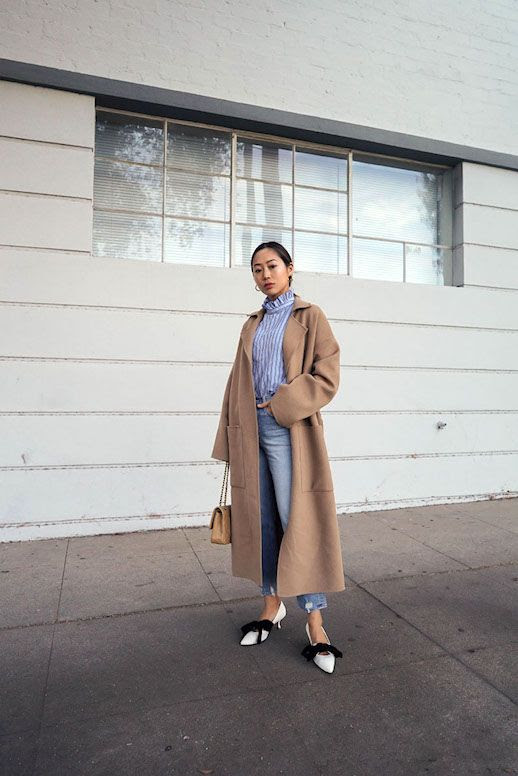 Le Fashion Blog Aimee Song Office Attire Ruffle Neck Striped Blouse Long Neutral Belted Coat Cropped Distressed Jeans White Bow Front Kitten Heels Via Songofstyle