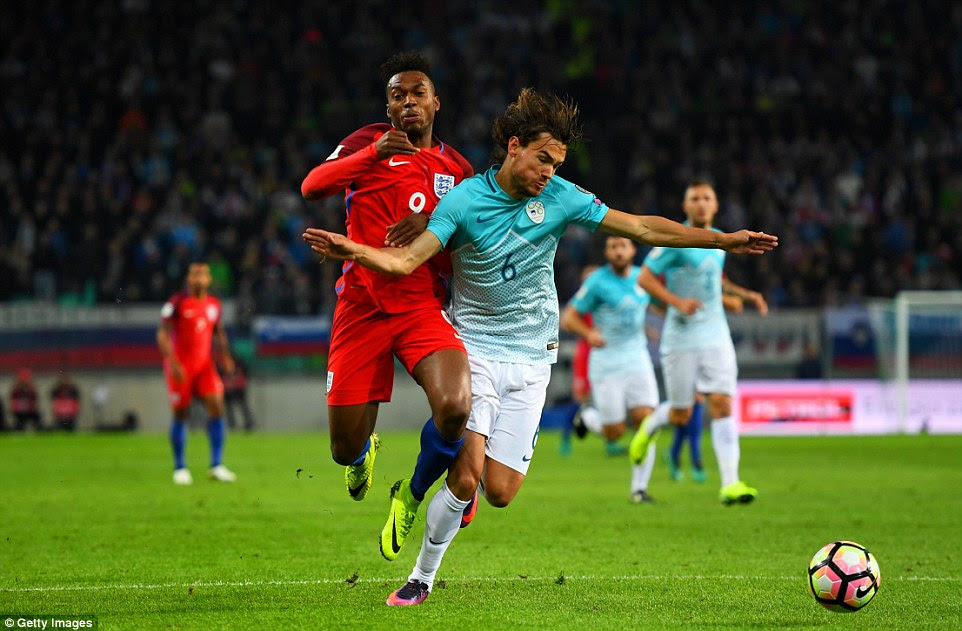 There were claims for a penalty in the first half when Daniel Sturridge went down under the challenge of Rene Krhin (right)