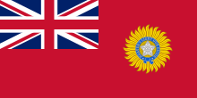 A British blue Ensign (a blue flag with the Union Jack placed at the top left corner) charged with the Star of India (five pointed star inside a circular band tied at the bottom)