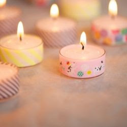 More than simple: just wrap tea lights with wash tape and you have an instant cute decoration.