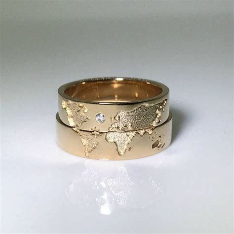 World map wedding bands. His and hers wedding rings set