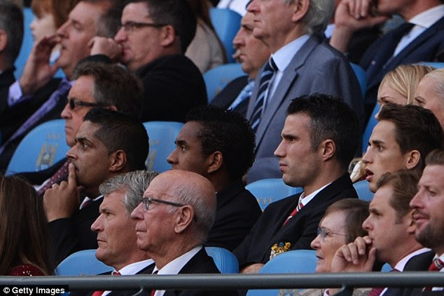 Face in the crowd: Robin van Persie missed the game through injury and watched from the stands