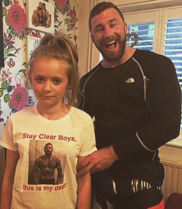 A dad created this t-shirt to keep the boys away from his daughter - and she doesn't look happy about it