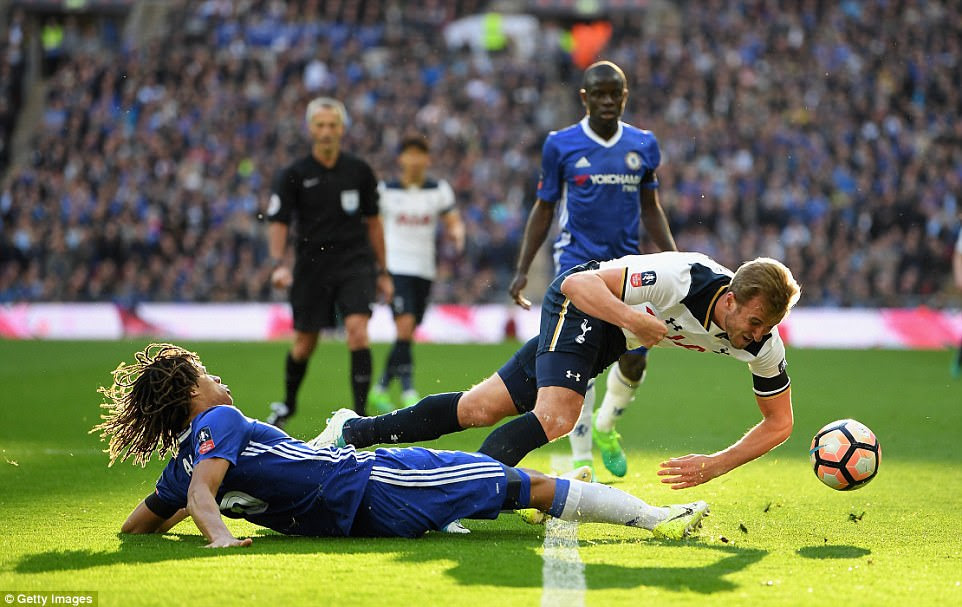 Tottenham striker Harry Kane is sent sprawling on to the turf following a slide tackle by Chelsea defender Nathan Ake