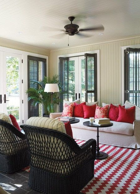 covered porch white sofa coral