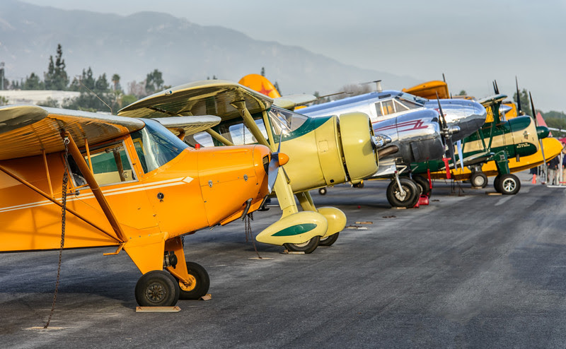 Vintage aircraft line-up in late afternoon light