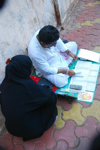 Street Astrologer and Muslim Lady by firoze shakir photographerno1