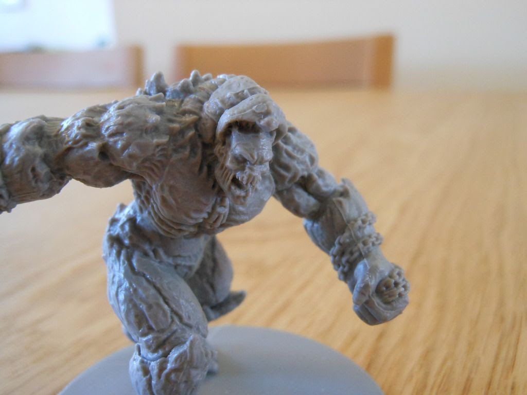 The huge berserker from the Gears of War board game, ready to destroy Fenix and his team of COGs.