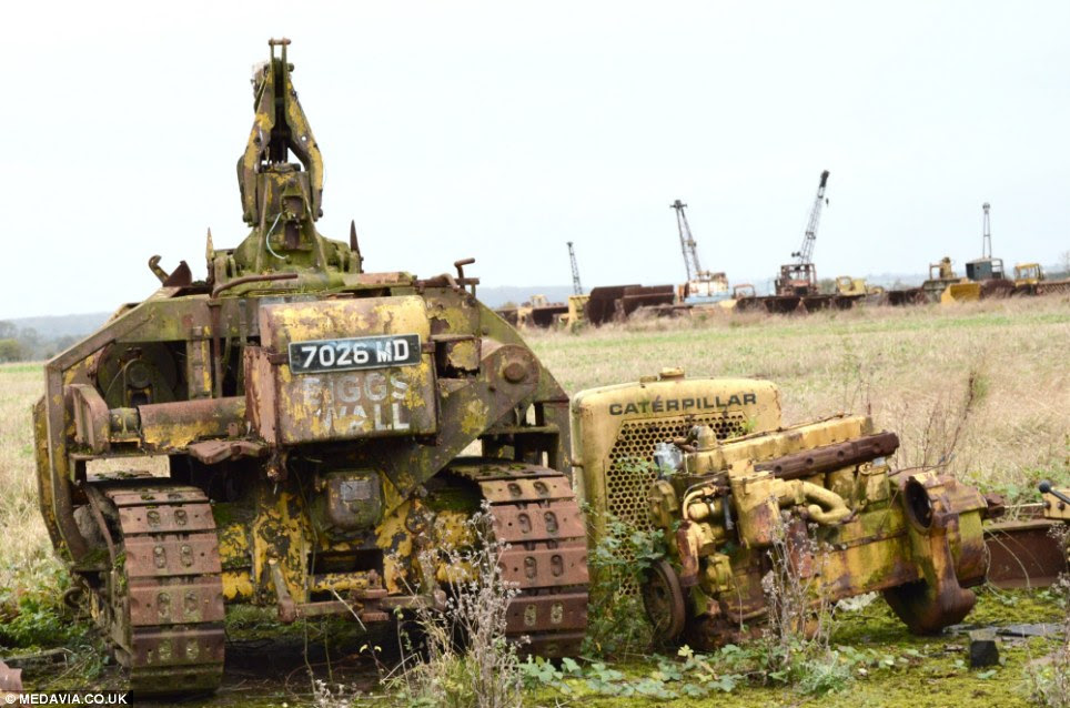 Left to rot: This military-used caterpillar tractor stands on the spot where it was dumped at a former RAF base left untouched for at least 50 years