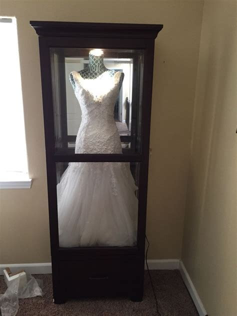 """Shadow box"" for wedding dress. Get a china cabinet and"