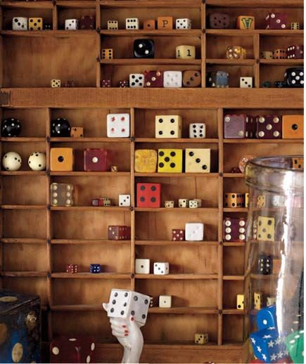Display collections of small items (like dice, matchboxes, or dollhouse miniatures) in a divided case like this printer's tray.